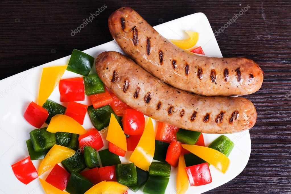 Grilled sausages with easy side dish of peppers, yellow, green, red