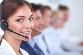 Fotografie Attractive Smiling positive young businesspeople and colleagues in a call center office