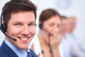Photo Attractive Smiling positive young businesspeople and colleagues in a call center office