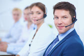 Fotografie Attractive positive young businesspeople and colleagues in a call center office