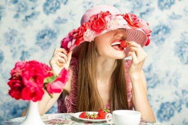 Vacationing woman eating strawberry