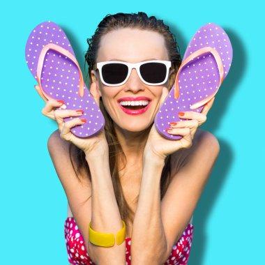 Happy girl with flip flops