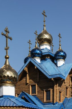 wooden orthodox church with domes
