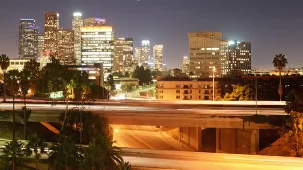 LA Skyline over Freeway Bridge at Night