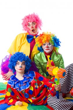 Three colorful funny clown on a white background