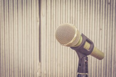 Microphone in the background of galvanized iron with Extremely s