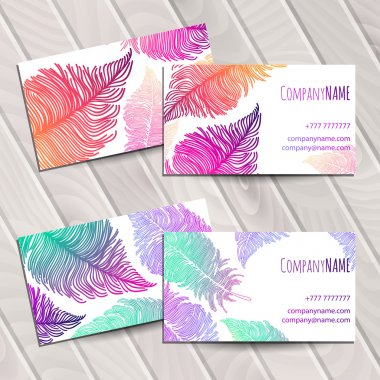 Business card with rainbow feathers