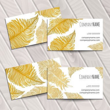 Business card with gold feathers