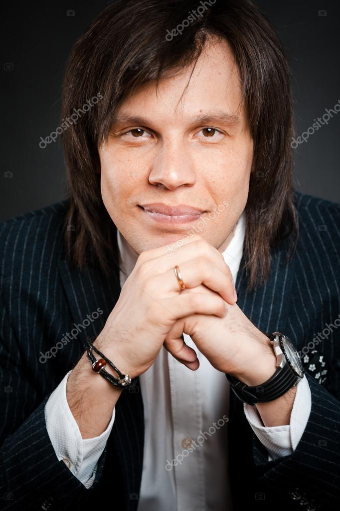 Handsome Man With Long Hair Brunette And Brown Eyes Dark Suit Wi