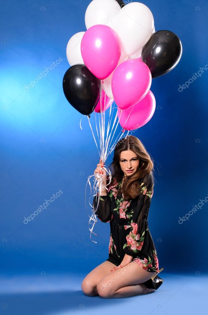 young woman with multicolored balloons