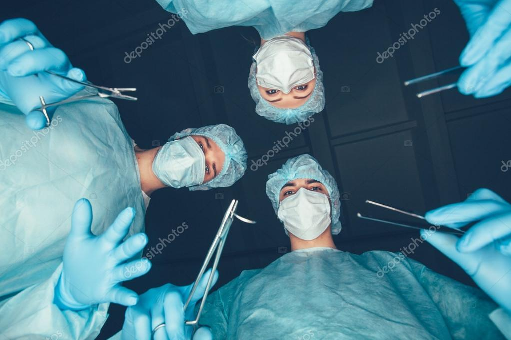 Surgeons Team Performing Operation in Stock Footage Video