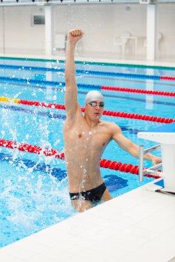 Winning Swimmer Young muscular preparing