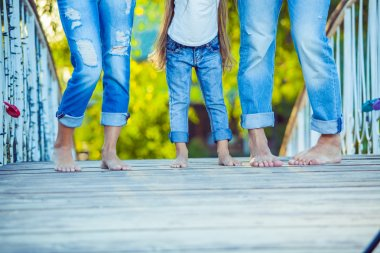 Happy Family on a Walk in Summer. Child with Parents Together. Feet Barefoot. Healthy Lifestyle. Dad Mom and Son. Spring Time