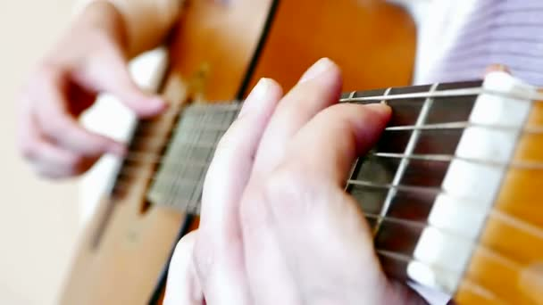 Playing On An Acoustic Guitar