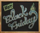 Black Friday calligraphy over blackboard