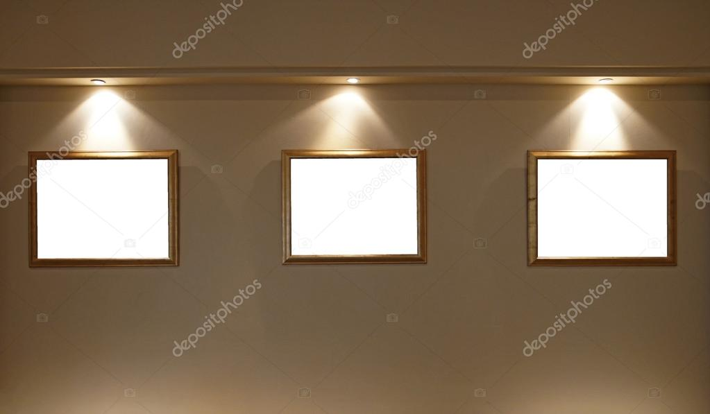Empty Picture Frames On The Wall With Lighting Stock Photo