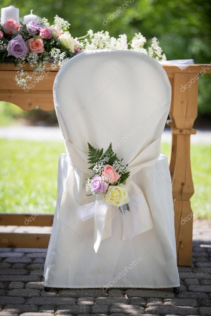 Wondrous Wedding Chair Covers With Fresh Roses Stock Photo Squirreltailoven Fun Painted Chair Ideas Images Squirreltailovenorg