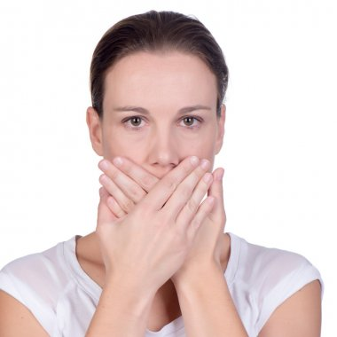 young woman covering her mouth with both hands