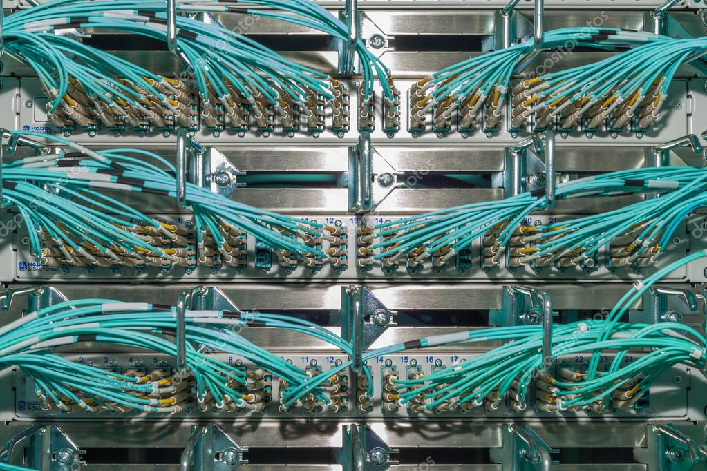 Great Fiber optic distributor in a datacenter with cables — Stock ...