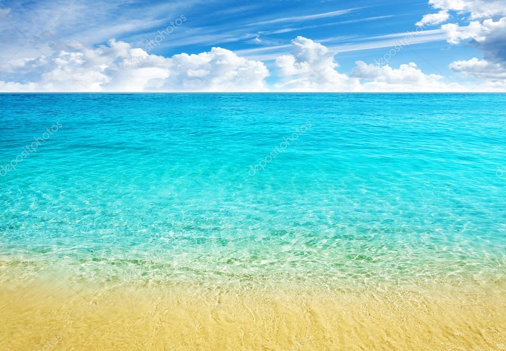 Summer Beach Background, Clear Water And Blue Cloudy Sky