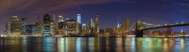 Manhattan skyline at night, New York panoramic picture, USA.