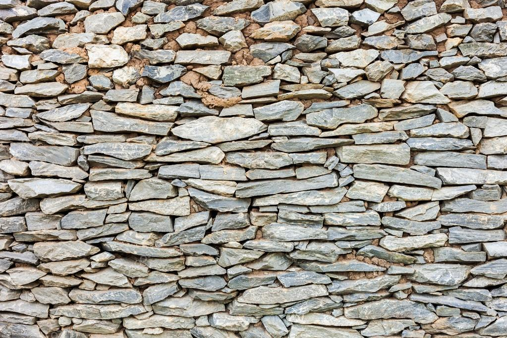Old abstract pattern of stone wall decorative surfaces