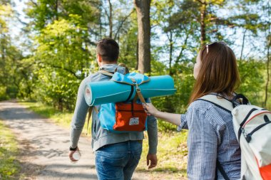 couple goes hiking, forest, recreation