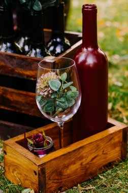 Beautiful decor with wine bottles, wooden boxes and other elemen