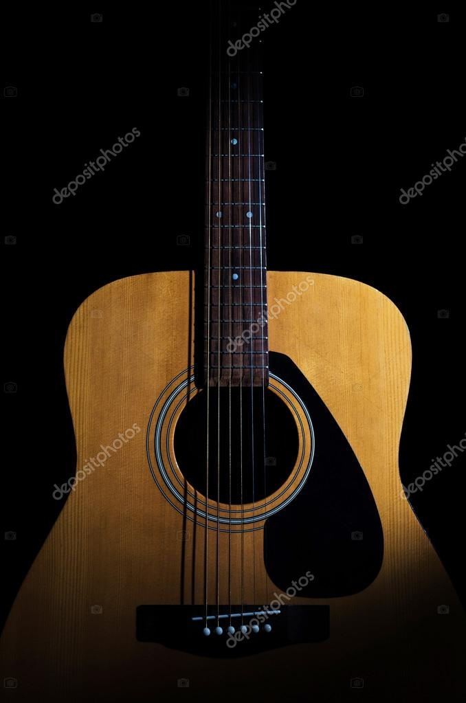 Acoustic Guitar On Black Background Close Up Stock Photo