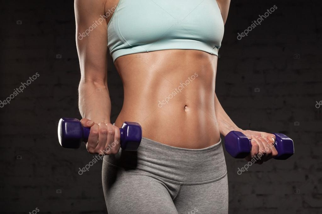 Fitness female woman with muscular body, do her workout with