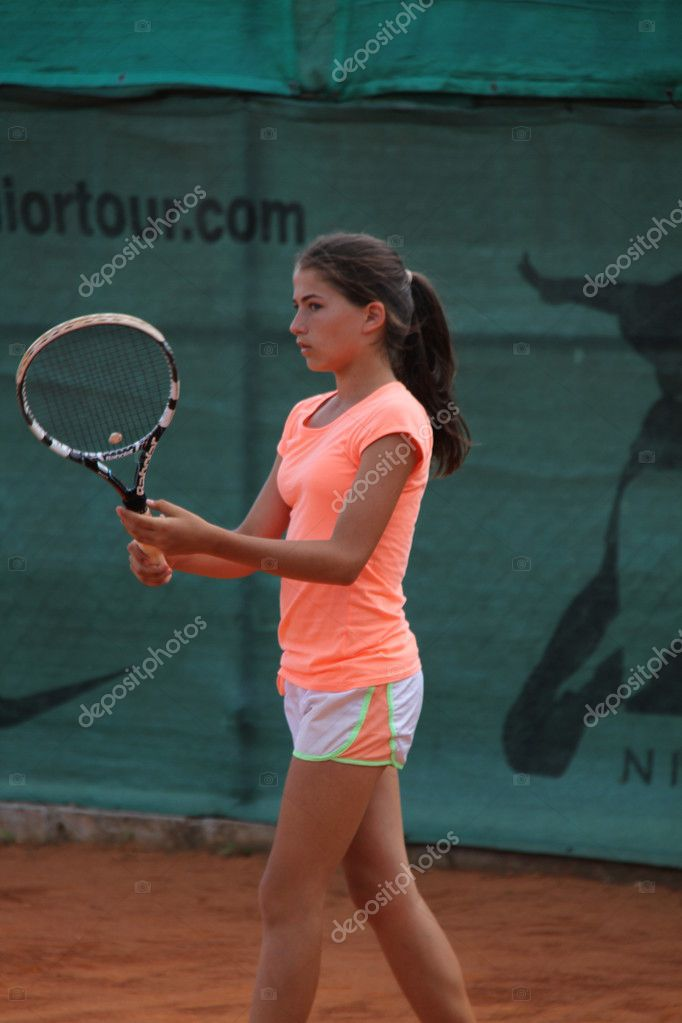 Beautiful Young Girl On The Tennis Court Stock Editorial Photo