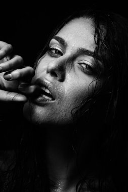 Wet woman portrait with water drops on the face. Black and white