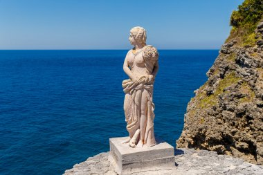 Vintage statue of a woman in classical style at the Fortune isla