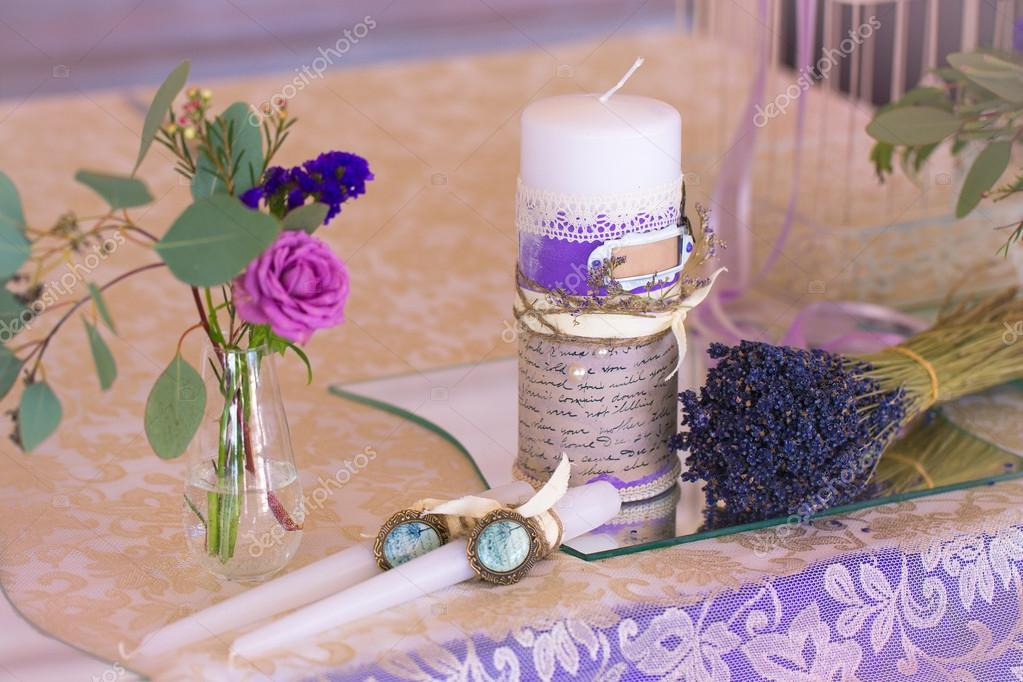 Decoration for wedding table in purple color . Flowers and candl