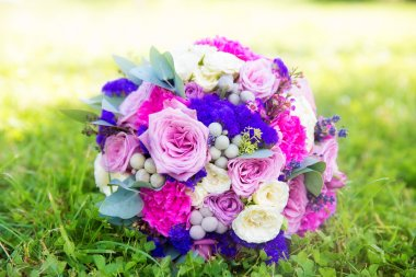 wedding bouquet of roses in purple tones. Floristic composition