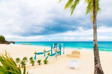 Wedding ceremony on a tropical beach in blue. Wedding arch decor