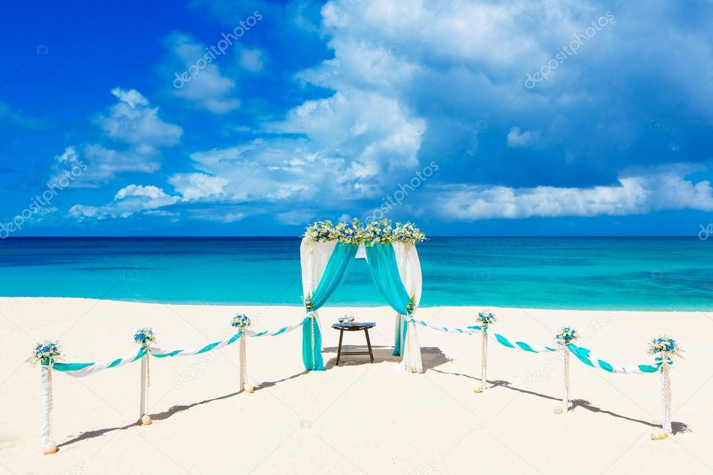 Wedding on the beach . Wedding arch decorated with flowers on tr
