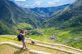 A man photographs the landscape. Rice terraces in the Philippine