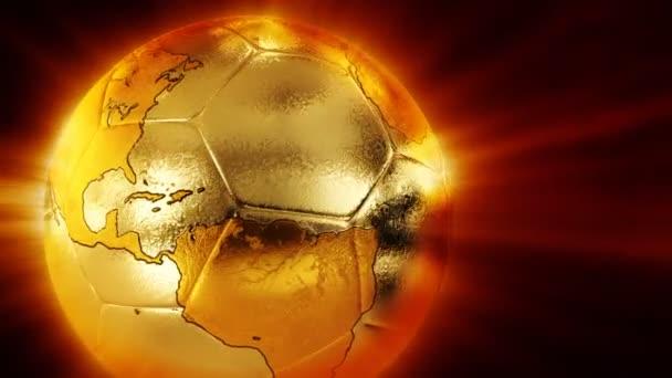 Zlatý fotbal s mapou světa