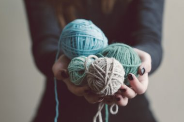 Holding a balls of yarn