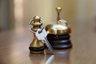 A service bell and room key