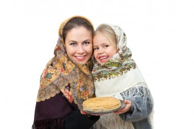 mother with her daughter  holds a plate of pancakes