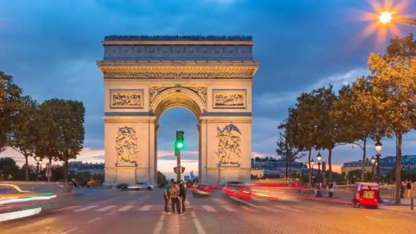 Arc de Triomphe - Paris traffic on Champs-Elysees at night HD