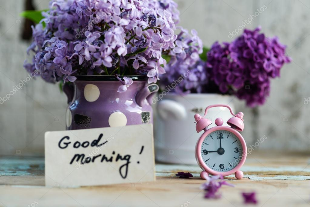 two tone lilac flowers with good morning note stock photo