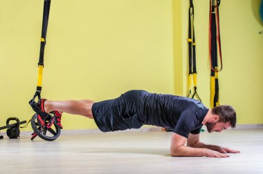 Gym training with trx fitness straps