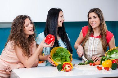Friendship and healthy lifestyle cooking at home.