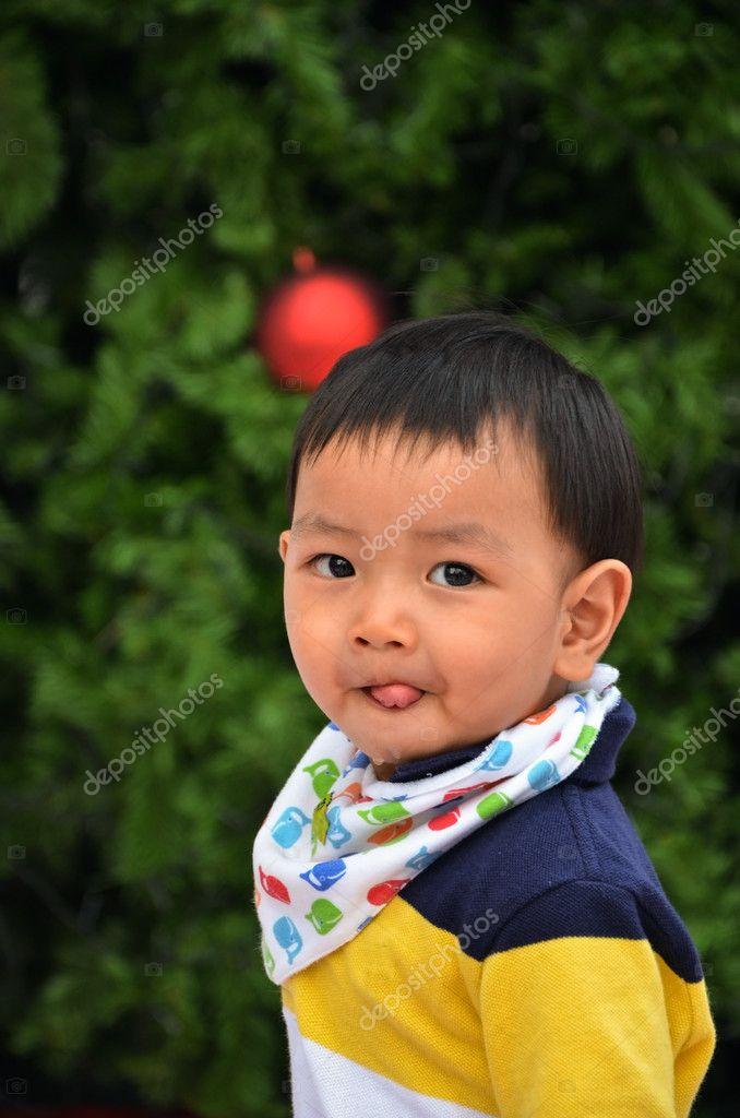 smile kid and the christmas tree — Stock Photo © sunyaluk #59172823