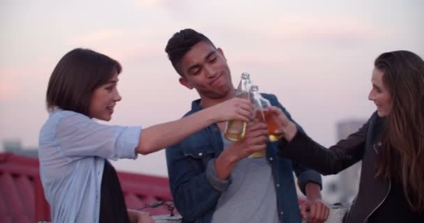 Teens celebrating a rooftop party at sunset