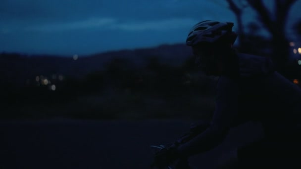 cyclist silhouette on mountain road