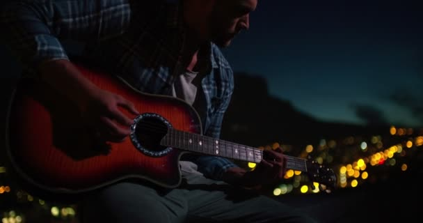 man playing guitar sitting on the rooftop at night — Stock Video ...